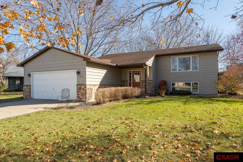 Location is great for this 4 bedroom bi-level home!  Main level has an open floor plan between the kitchen, dining, and great room along with an inviting 3-season room off the back. The lower level has a very spacious living room with a cozy wood burning stove. There are 2 additional bedrooms and a bathroom in this lower level. The backyard has a private feel with mature trees. Call today for a private showing.