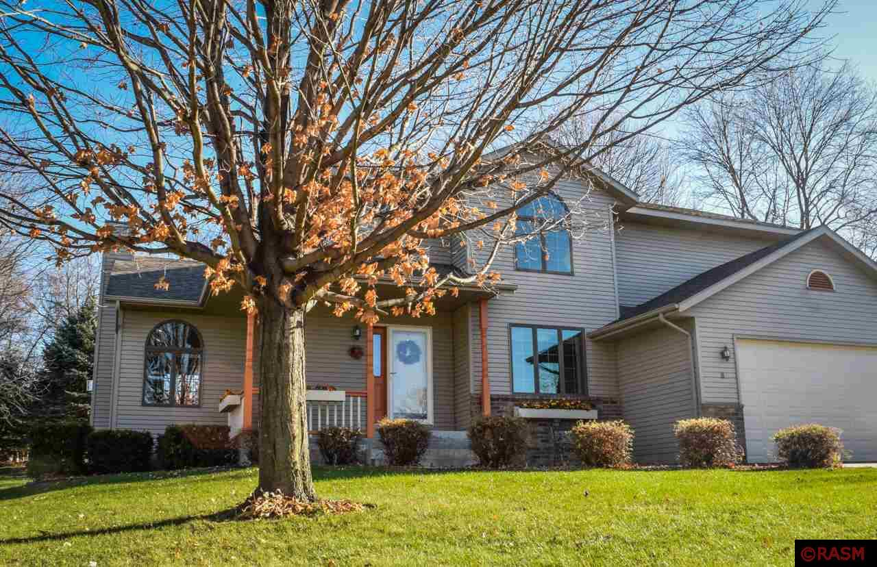 Situated near a beautiful duck pond, in a wooded New Prague neighborhood, this gorgeous 4 bed, 4 bath luxury home features plenty of main level living space for entertaining a large family with its welcoming foyer, massive country-style kitchen & dining room, great room with fireplace, 4 season sun room, and office overlooking the pond. The lower level features a sizeable den & fireplace, and a modern wet bar. Aside from an attached 3 stall garage, this home boasts a large and private back yard with deck and storage shed.