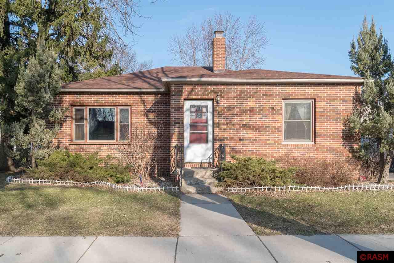 Classic curb appeal in this well-built brick rambler home! Featuring a spacious living with wood burning fireplace,  a pocket door to the eat-in kitchen, 3 main floor bedrooms all with hardwood floors and a full bathroom. There is cozy breezeway leading to the 1-stall garage. Other extras and highlights include a charming arched entry, hallway built-ins, original woodwork and nice future expansion potential or good storage room in the full block basement featuring a 2nd fireplace and an egress window. Newer furnace, A/C, roof and windows were replaced in 2016.  Water softener, is a new $2500 Kinetico, and it is owned. This home is priced to sell!