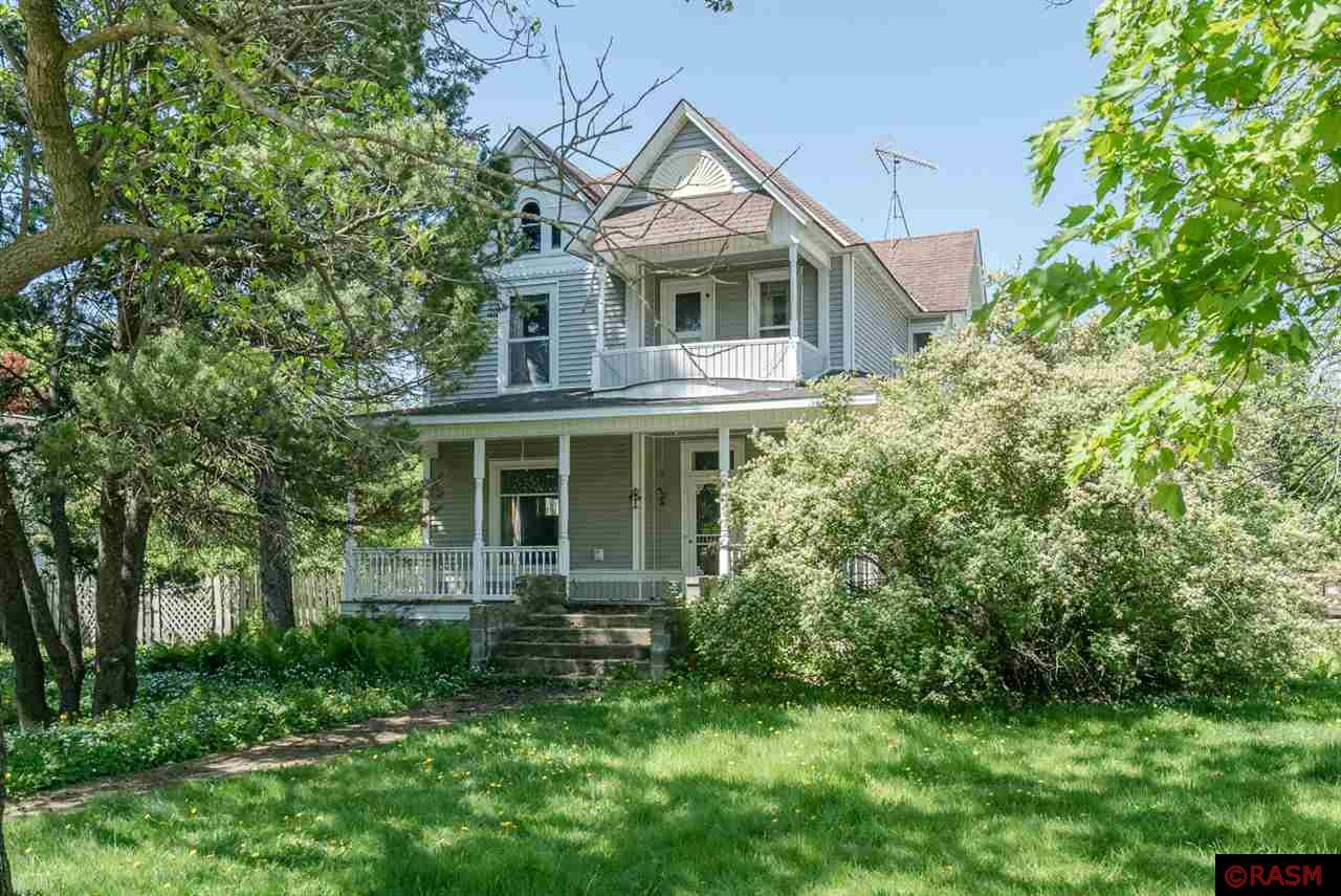 Built in 1900, this classic home sits in the heart of Vernon Center. It was built by the owner of the lumber mill in town and is preserved beautifully. The grand wrap-around porch is perfect for summer evenings. The entryway and living room are very impressive with its original woodwork, fireplace and hardwood floors.  On the main floor you will also find the formal dining room, library, full kitchen, master closet and separate bedroom, and a ¾ bathroom. Upstairs are 4 bedrooms, laundry room/bathroom combination, and a walk out deck to the front yard.  The garage is a detached double. Call today for a private showing.